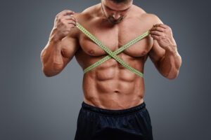 bodybuilder-measuring-waist-with-tape-measure